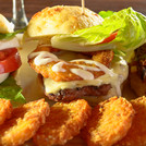 Three delicious sliders: Vegetarian, Nick's famous cheeseburger and Schindo with potato pancakes.