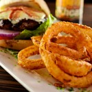 A delicious half pound bacon cheeseburger and golden onion rings.