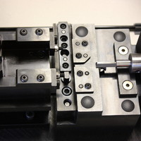 Precision machined components assembled to work as an insertion fixture..
