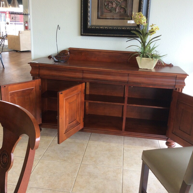 This buffet by Ethan Allen is gorgeous!  Lovely simple, clean lines with a rich, dark wood finish define this piece. It features 3 drawers with dovetail jointing and an adjustable shelf behind 3 cabinet doors.