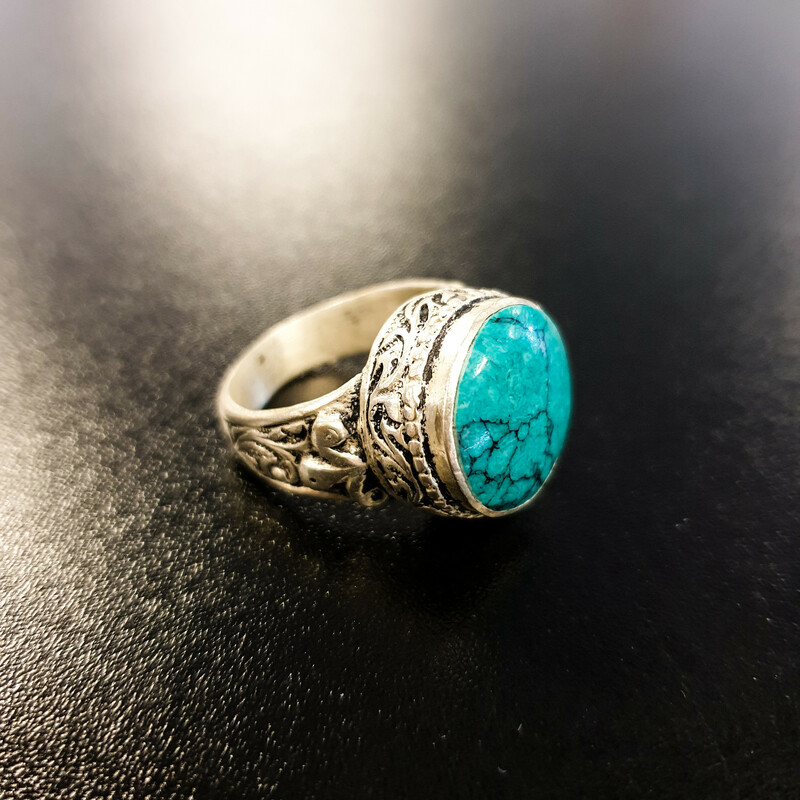 Beautiful Turquoise Ring.<br /> - Silver-tone frame<br /> - Turquoise stone<br /> - Engraved details<br /> - Stone length: .65 in.<br /> - Size 7.5<br /> <br /> * Please note that these measurements and pictures are for reference only and may vary slightly from the original.