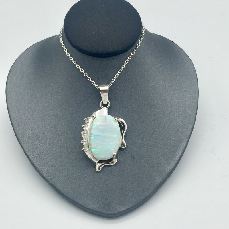STERLING SILVER<br /> WEIGHT 6.8 DWT<br /> CHAIN NOT INCLUDED<br /> <br /> CREATED OPAL WITH 5 CZ ACCENT PRONG SET STONES.<br /> <br /> <br /> <br /> <br /> SS LG CREATED  OPAL PEND, WHITE,