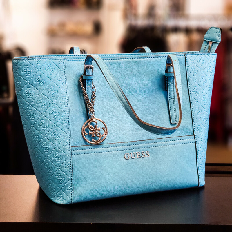 Beautiful Guess Purse.<br /> - Light blue exterior<br /> - Zip-top closure<br /> - Two adjustable handles with 12 in. drop<br /> - Interior features: one zip pocket and three slip pockets<br /> - W: 15.5 in. H: 10 in. D: 5.5 in.<br /> <br /> * Please note that these measurements and pictures are for reference only and may vary slightly from the original.