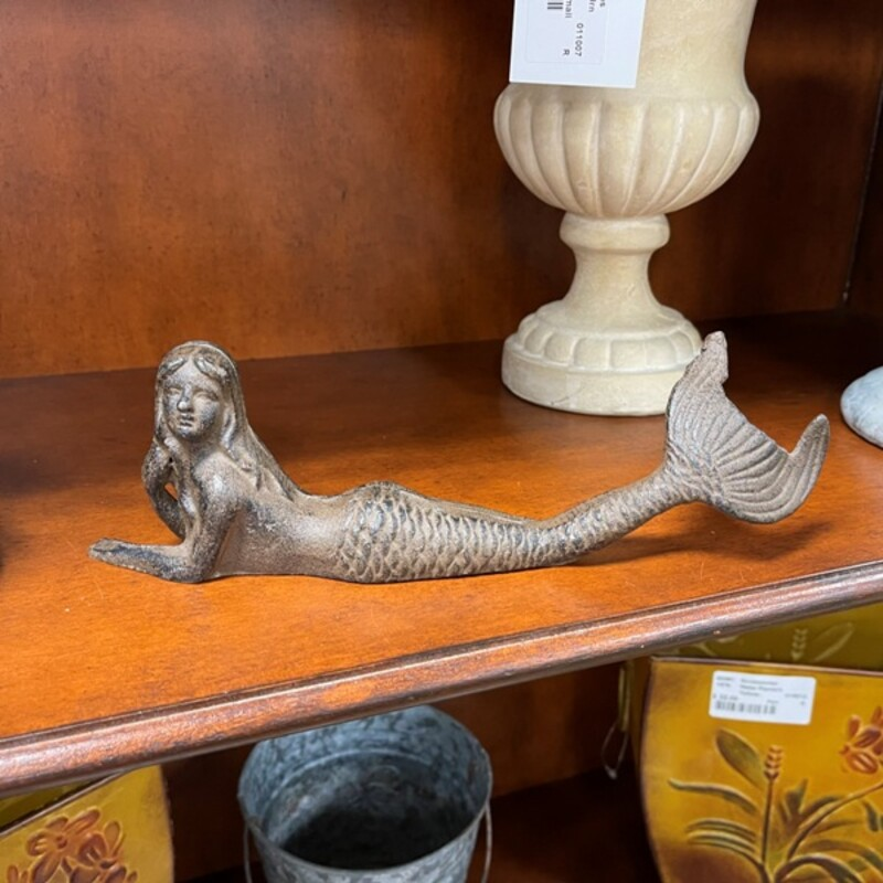 Cast Iron Mermaid.