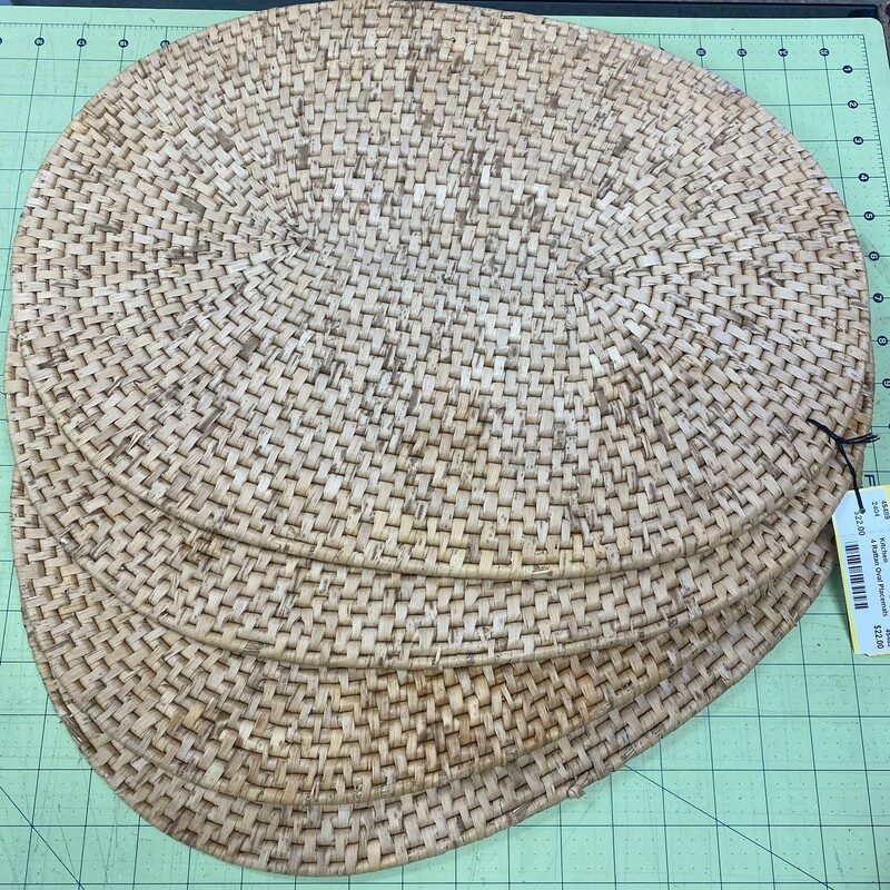 4 Rattan Oval Placemats.