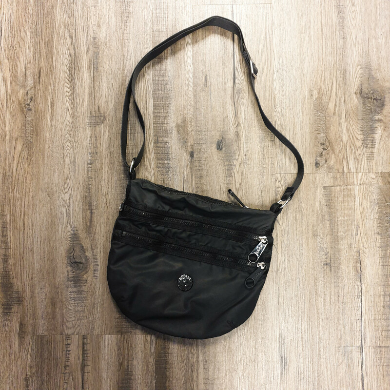 Beautiful Kipling Crossbody.<br /> - Black color<br /> - Front zip pockets<br /> - Zip-top closure<br /> - Adjustable shoulder strap with 25 in. drop<br /> - Interior features: one zip pocket<br /> - W: 12 in. H: 10.5 in. D: 1 in.<br /> <br /> * Please note that these measurements and pictures are for reference only and may vary slightly from the original.