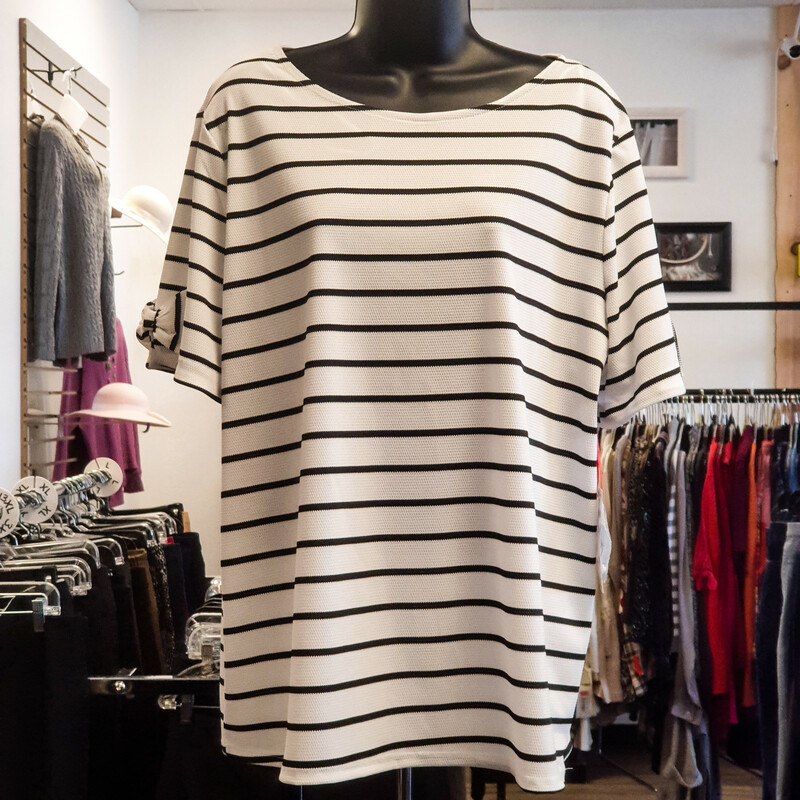 Beautiful Elle Top.<br /> - Brand new<br /> - White and black color<br /> - Striped design<br /> - Sleeves ribbon destails<br /> - Stretchy<br /> - Bust circumference: 47 in.<br /> - Length: 27 in.<br /> - Sleeves length: 9 in.<br /> - Size 2XLarge<br /> <br /> * Please note that these measurements and pictures are for reference only and may vary slightly from the original.