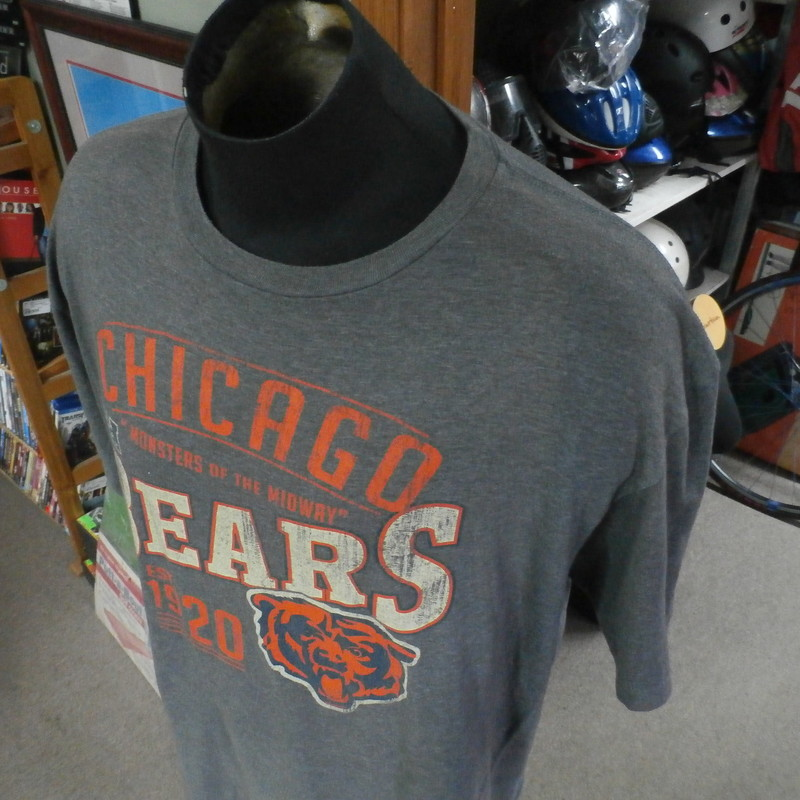 Chicago Bears retro shirt grey size 2XL cotton/polyester blend #26071<br /> Rating: (see below) 3- Good Condition<br /> Team: Chicago Bears<br /> Player: n/a<br /> Brand: NFL Team Apparel<br /> Size: Men&#039;s XXLarge (Measured Flat: chest 26&quot;, length 30&quot;)<br /> Color: gray<br /> Style: short sleeve; screen printed<br /> Material: 50% cotton 50% polyester<br /> Condition: 3- Good Condition; wrinkled; material is stretched and worn from wearing and washing; some pilling and fuzz; some fading and discoloration; no rips or tears; no stains; light marks along tops of shoulders (see photos)<br /> Item #: 26071<br /> Shipping: FREE