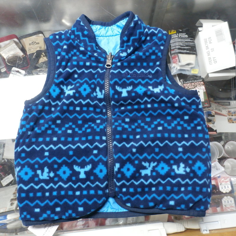 "Columbia YOUTH reversible vest blue size 24 Months 100% polyester #26073<br /> Rating: (see below) 2- Great Condition<br /> Team: n/a<br /> Player: n/a<br /> Brand: Columbia<br /> Size: YOUTH 24 Months (Measured Flat: chest 12"", length 13"")<br /> Color: blue<br /> Style: sleeveless; embroidered<br /> Material: 100% polyester<br /> Condition: 2- Great Condition; wrinkled; material is stretched and worn from wearing and washing; some pilling and fuzz; some fading and discoloration; no rips or tears; no stains (see photos)<br /> Item #: 26073<br /> Shipping: FREE"