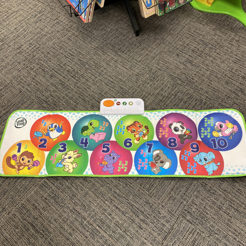 Leap Frog Musical Mat<br /> <br /> Skills learned include gross motor skills, music & rhythm, and numbers. Requires 3 AAA batteries, included for product demonstration only<br /> Twist, dance, leap, laugh, count and learn with the learn and groove musical mat - designed especially for active toddlers. Keep little ones moving and exploring with 50+ songs and phrases and 3 ways to play<br /> Bring music and learning to life with every step with a fully interactive jumbo playmat that's over 4-feet long. Identify numbers 1 to 10, and count claps, beats and more with animal friends<br /> Share the fun with family or friends. Two can play together or take turns. Step on the circles on the mat for open-ended play to explore numbers, instrument names and sounds, and animal characters<br /> Step on circles 1-9 to hear 1 of 9 children's tunes or step on circle 10 for free-play and create your own tune. Listen and follow the audio instructions to make as many correct moves as you can before the sequence ends