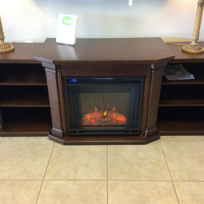 BARGAIN ALERT!!!! This little electric fireplace/ media center is both practical AND affordable, priced at only $395! It appears to be wood, but its difficult to be certain, hence the bargain price. Each side has 2 shelves and  the top shelf on each side has openings on the back for cords. The firplace has multiple settings and a remote control!