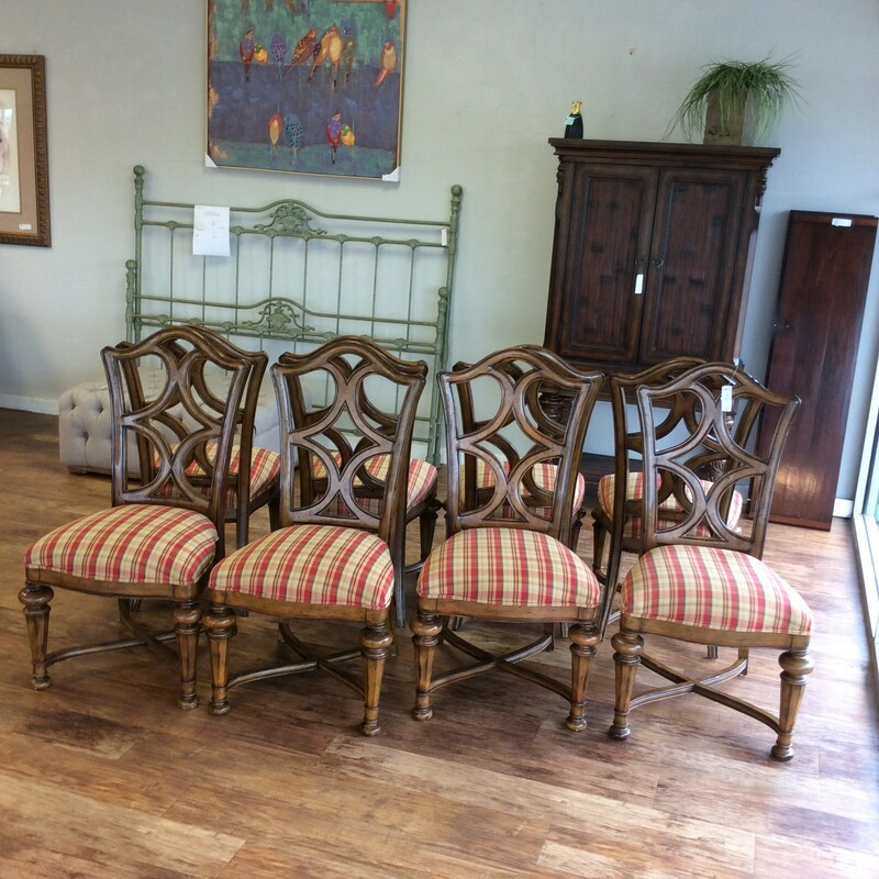 BARGAIN ALERT!!! If you are in the market for 8 matching dining chairs, this set may be the one for you! They are solid wood and have a 2-toned walnut finish. The the seats are upholstered in a cheery red, maize, olive, moss and brown plaid and it is in excellent condition. ONLY $595!!!