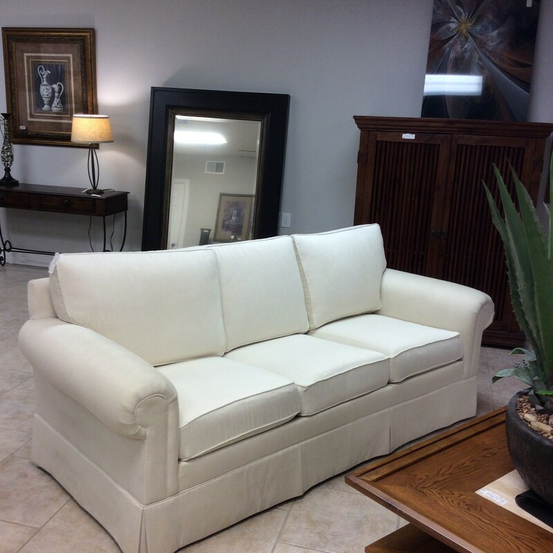 BARGAIN ALERT!! This is a lovely sofa by Ethan Allen, so you know it's a good, well-made piece of furniture.Traditional and classic lines, it's been upholstered in a creamy off-white. Skirted with rolled arms it's been priced at only $395.! reflecting just a little bit of wear on one arm. Come on in and take a look, it won't last.