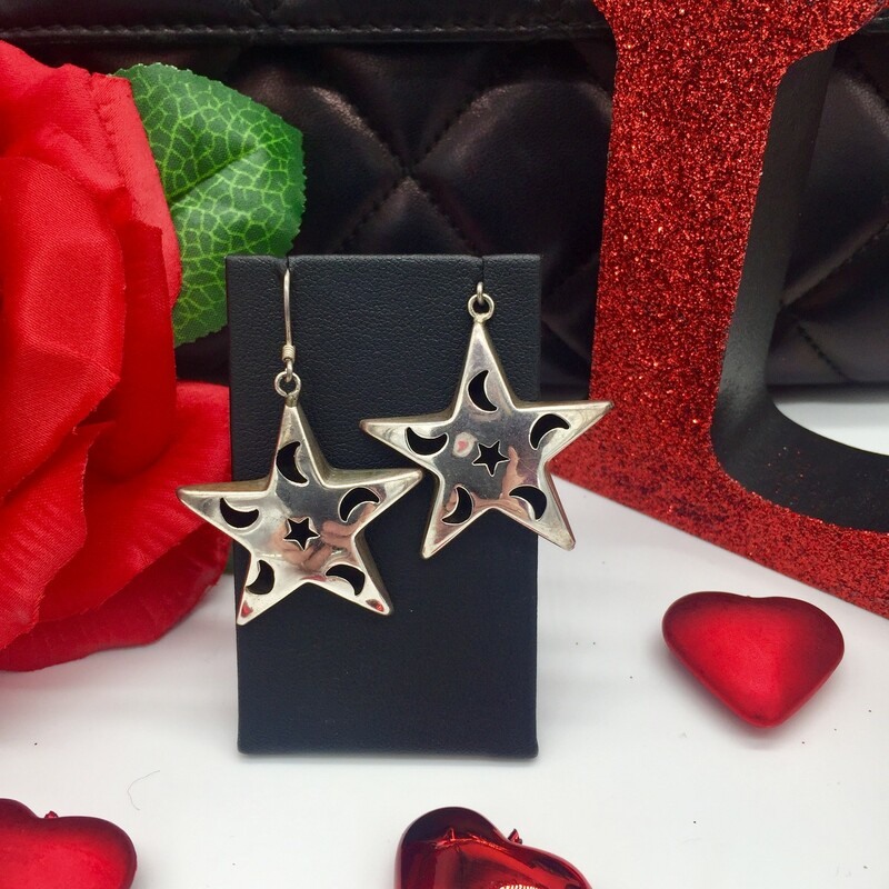 STERLING SILVER<br /> WEIGHT 6.5 DWT<br /> <br /> LARGE STAR DANGLE EARRINGS WITH MOON AND STAR ACCENT DESIGN ON THEM.<br /> <br /> <br /> <br /> <br /> SS STAR MOON DANGLES, SILVER, Size: SH