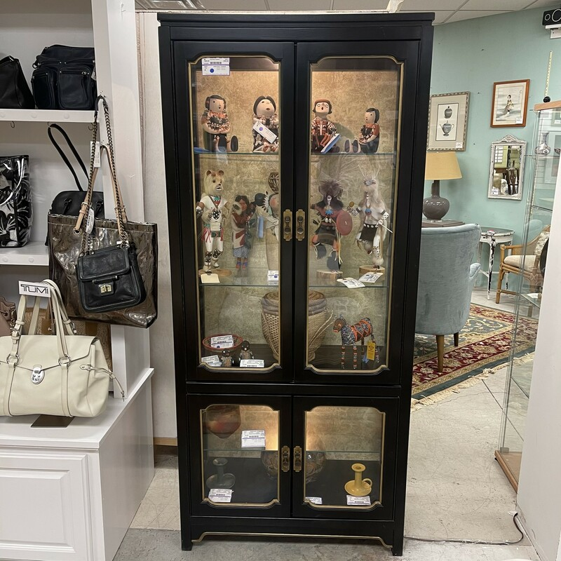 Vintage Black Glass Cabinet, 4 doors. Both the upper compartment and the lower compartment have lights. Size: 32L x 16D x 70H<br /> <br /> This item is not eligible for shipping - local pickup only.