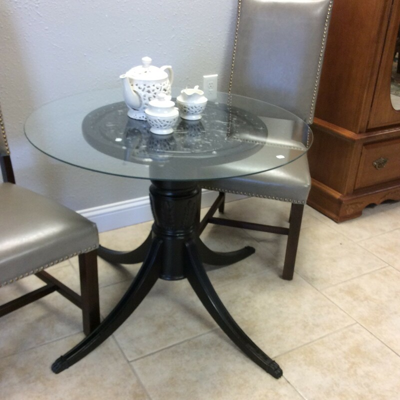 This little 2 piece table is really cute. The base appears to be solid wood and has a matte black-over-brown painted finish. The round glass topper is 36 inches in diameter.This would be a great table for 2 people to play games, or enjoy a beverage or two. ONLY $195!