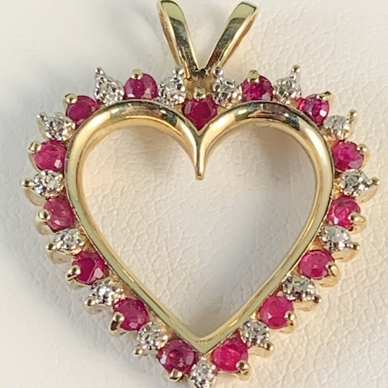 Natural Ruby & Diamond Heart Pendant.<br /> Rubies total approximately 1/2 carat.<br /> Diamonds are accent only but have illusion of 1/2 carat.<br /> Rabbit Ear Bail<br /> Chain Sold Seperately.<br /> 10 Karat Yellow Gold<br /> $399