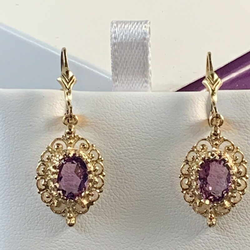 Oval Amethyst with Filigree Border Dangle Earrings<br /> Lever back style. 8 x 6mm. Medium color.<br /> $355