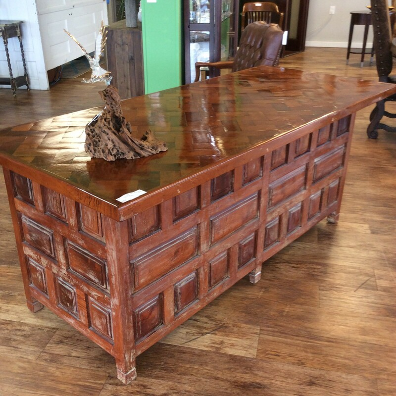 This is a very unique rustic desk with a wood patterned  herringbone desk top. It has 5 solid wood drawers. A very heavy solid wood piece with an unusual cut out wood pattern on front as well as the back. This may not last long!