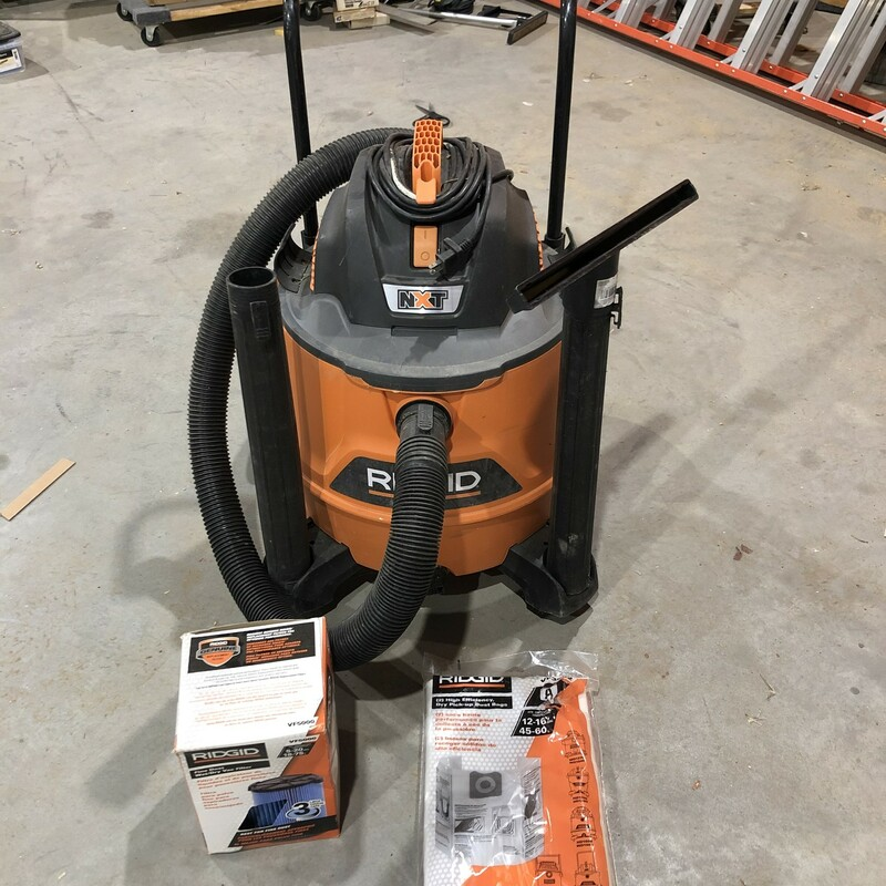 Ridgid HD1800 16 Gal. 6.5-Peak HP NXT Wet/Dry Shop Vacuum with Cart. Comes with New VF5000 Filter & 2 New VF3502 Dust Bags. Vacuum is Missing a Hold Down Clip That Does Not Effect The Functionality of The Machine.