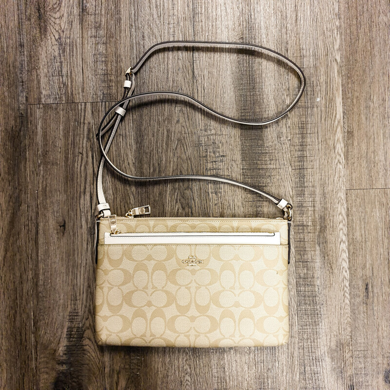 Beautiful Coach H1861 F58316 Crossbody.<br /> - Tan and white color<br /> - Zip-top closure<br /> - Front slip pocket with removable pouch<br /> - Back card slip<br /> - Adjustable shoulder strap with 24 in. drop<br /> - Interior features: one slip pocket<br /> - W: 10.5 in. H: 7 in. D: 1.25 in.<br /> <br /> * Please note that these measurements and pictures are for reference only and may vary slightly from the original.