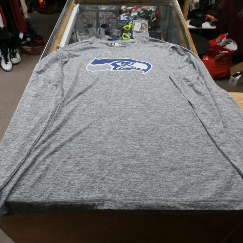 Seattle Seahawks VF Imagewear Men&#039; Long Sleeve Shirt Size Large Gray #17446<br /> Rating: (see below) 2 -  Great Condition<br /> Team: Seattle Seahawks<br /> Player: Team<br /> Brand: VF Imagewear<br /> Size: Men&#039;s - Large(Measured Flat: Across Chest: 22&quot;; Length 30&quot;)<br /> Measured Flat: armpit to armpit; top of shoulder to bottom hem.<br /> Color: Gray<br /> Style: Long sleeve scream pressed shirt<br /> Material: 100% Polyester<br /> Condition: 2 - Great Condition - wrinkled; material looks and feels great; clean and crisp; normal signs of use; no stains rips of holes<br /> Item #: 17446<br /> Shipping: FREE