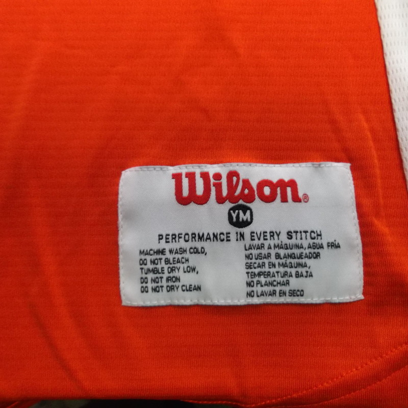 "Chargers #21 YOUTH Wilson Baseball Jersey Size Medium Orange Polyester #7783<br /> Rating:   (see below) 2 - Great Condition<br /> Team: Chargers<br /> Player: #21<br /> Brand: Wilson<br /> Size: Medium- YOUTH(MEASURED FLAT- Chest 18""; Length 28"")<br /> Color: Orange<br /> Style: Screen pressed baseball jersey<br /> Material: 100% Polyester<br /> Condition: - Great Condition - wrinkled; Material looks and feels like new; Original tags; Small hole from being tags on the back of the collar; No stains or rips(See Photos for condition and description)<br /> Shipping: $3.37<br /> Item#: 7783"