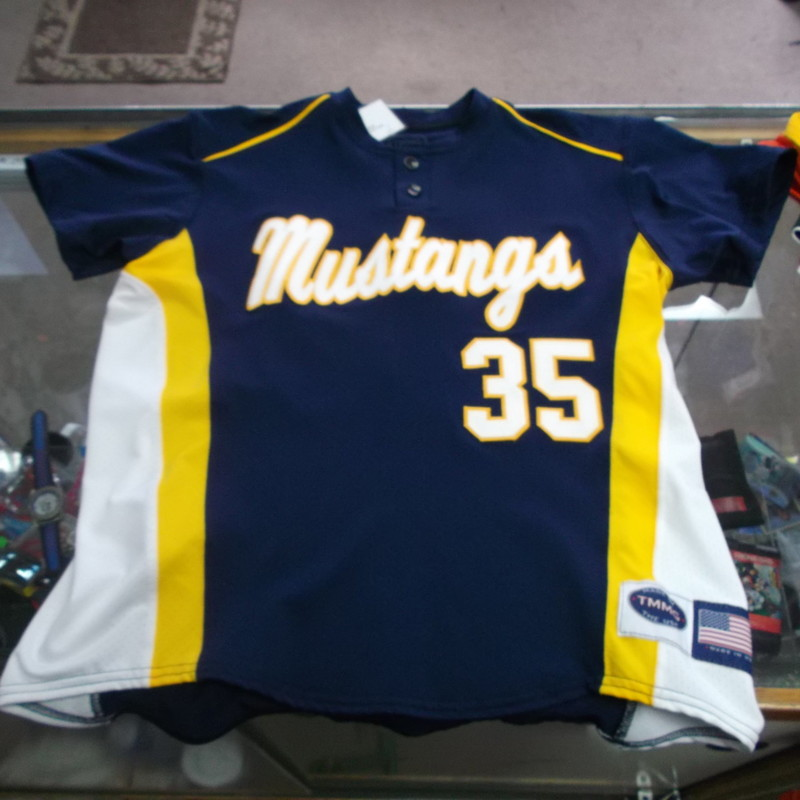 "Mustangs #35 YOUTH TMMG Baseball Jersey Size XL Blue Nylon Blend #7784<br /> Rating:   (see below) 1 - Excellent Condition<br /> Team: Mustangs<br /> Player: #35<br /> Brand: TMMG<br /> Size: XL - YOUTH(MEASURED FLAT- Chest 21""; Length 24"")<br /> Color: Blue<br /> Style: Embroidered baseball jersey<br /> Material: 100% Polyester<br /> Condition: - Excellent Condition - wrinkled; Material looks and feels like new; Original tags; No stains rips or holes(See Photos for condition and description)<br /> Shipping: $4.20<br /> Item#: 7784"