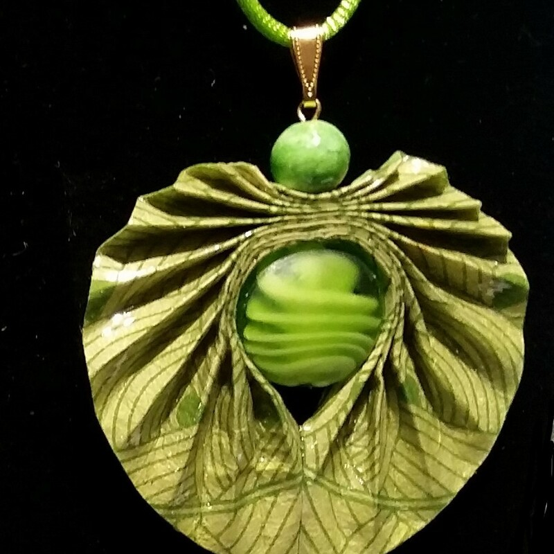 "Pleated Necklace: Pleated green patterned lokta paper pendant with green glass beads on 18"" green satinique cord.  Paper has acrylic coatings for durability."