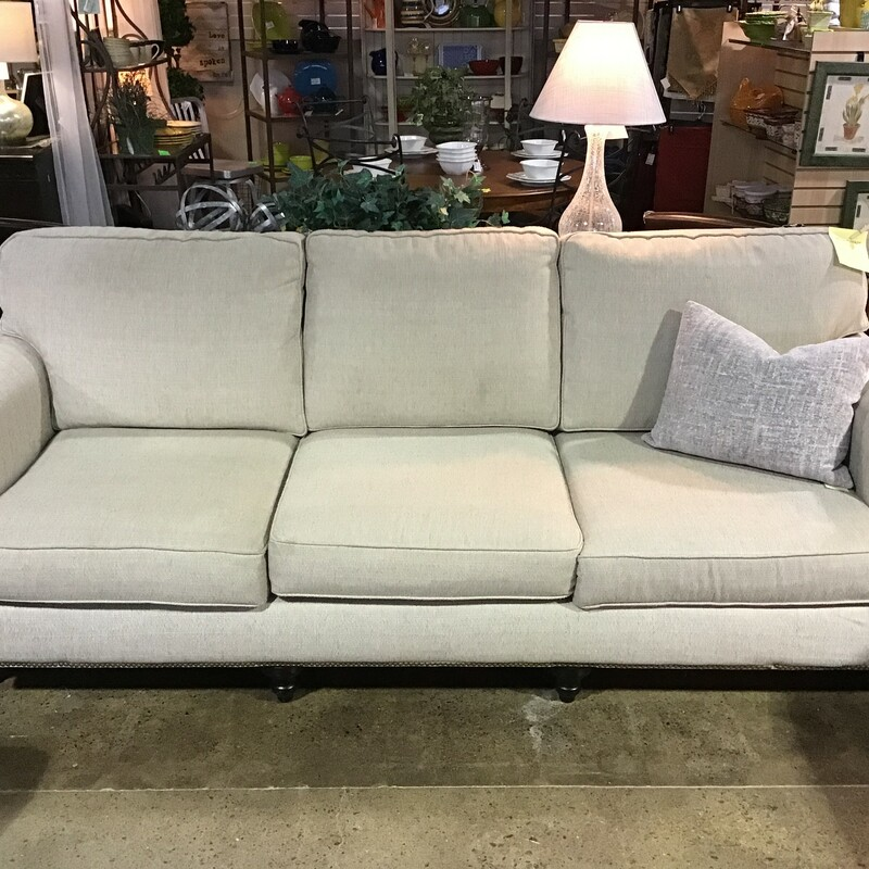 "This super neutral cream upholstered sofa has tweed fabric and rolled arms. There are 3 flippable bottom cusions and 3 stationary back cushions. The bottom has nailhead accents.Great sofa that would go with any decor style!<br /> Dimensions are 96"" x 39"" x 36"""