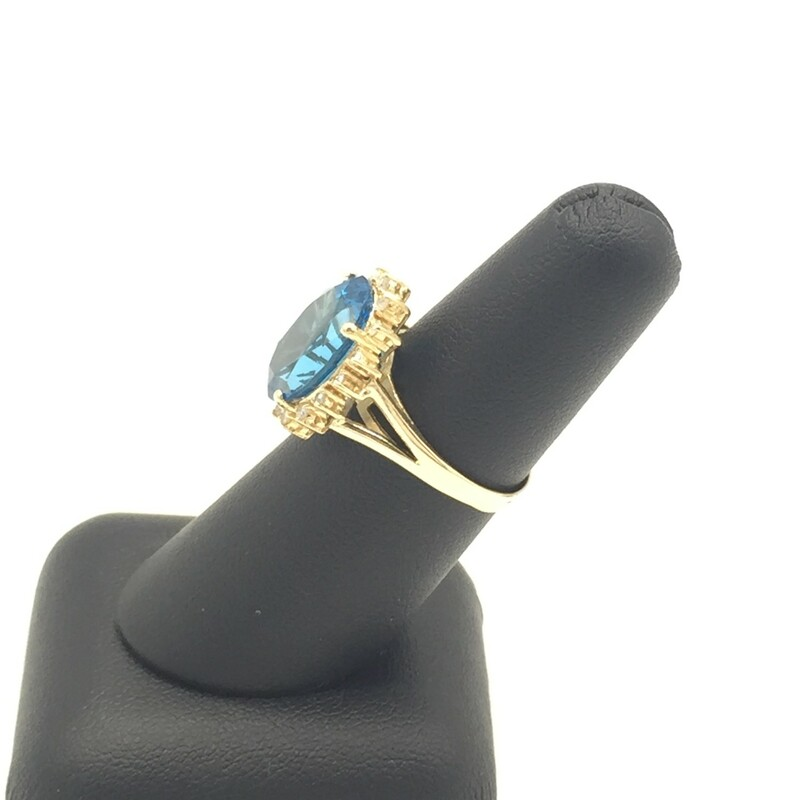 14KT YELLOW GOLD<br /> LG OVAL BLUE TOPAZ CENTER STONE<br /> APX. 1/3CTTW DIAMOND HALO<br /> FINGER SIZE 5<br /> (CAN BE REISIZED)