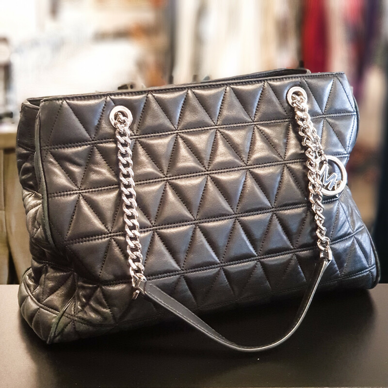 Beautiful Michael Kors Purse.<br /> - Black color<br /> - Quilted exterior<br /> - Magnetic button closure<br /> - Two handles with 10 in. drop<br /> - Interior features: three compartments, four slip pockets and two zip pockets<br /> - Footed bottom<br /> - W: 13 in. H: 10 in. D: 5.5 in.<br /> <br /> * Please note that these measurements and pictures are for reference only and may vary slightly from the original.