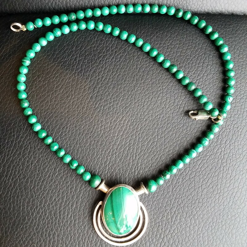 "Malachite and Silver Vintage Necklace There are not silver markings but has been tested.<br /> Malachite is a stone of balance, abundance, manifestation and intention.  An extremely powerful metaphysical stone, Malachite is often called the ""stone of transformation"" and is used for deep energy cleaning, bring health and positive transformation to the wearer.<br /> 16""<br /> PRICE IS LOWER THAN IN THE STORE FOR THE SHIPPING CHARGE"