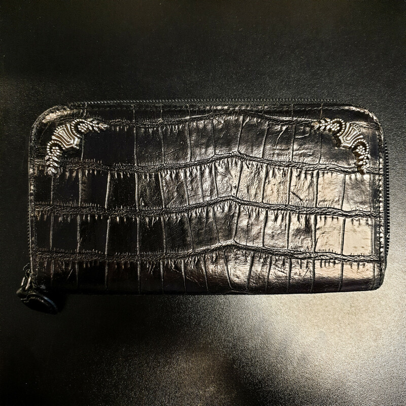 Beautiful Brighton Wallet.<br /> - Black exterior<br /> - Silver details<br /> - Zip-top closure<br /> - Interior features: one zip pocket, eight card slips and two slip pockets<br /> - W: 8 in. H: 4.5 in. D: .75 in.<br /> <br /> * Please note that these measurements and pictures are for reference only and may vary slightly from the original.