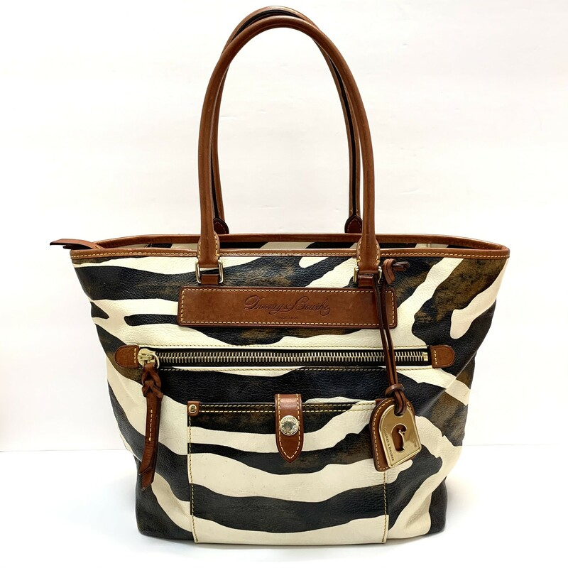Dooney & Bourke Tote<br /> Black & Cream Zebra print<br /> Tan handles<br /> Gorgeous red interior