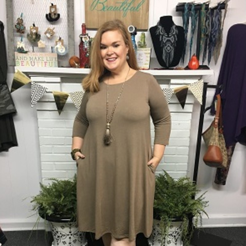 Check Out our Zenana Pocket Dress it is absolutely gorgeous. It is great for your fall collection and will look cute with a pair of long boots. The material is made of 55% Polyester 40% Rayon 5% Spandex with a length of 37in.