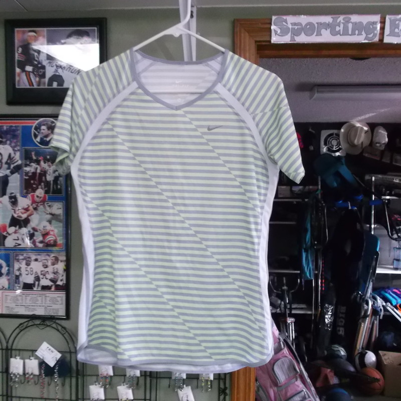 Nike Dri-Fit women&#039;s striped shirt crew neck size Medium 100% Polyester #7969<br /> Rating:   (see below) 2 - Great Condition<br /> Team: N/A<br /> Player: N/A<br /> Brand: Nike<br /> Size: Medium Women&#039;s(MEASURED FLAT - Chest 18&quot;; Length 25&quot;) armpit to armpit &amp; top of shoulder to bottom hem<br /> Color: Green/ Gray striped<br /> Style: athletic shirt; short sleeve; Crew Neck; lightweight<br /> Material: 100% polyester; <br /> Condition: - Great Condition - wrinkled; No rips or holes; pilling;  (See Photos for condition and description)<br /> Shipping: $3.37<br /> Item#: 7969