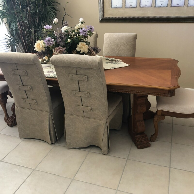 Solid wood dining table with four palm chairs and four green parson chairs in very good condition, Used, Size: 8 Chairs.  Check out item 20945 for optional matching side buffet sold separately.<br /> <br /> Dimensions to follow.