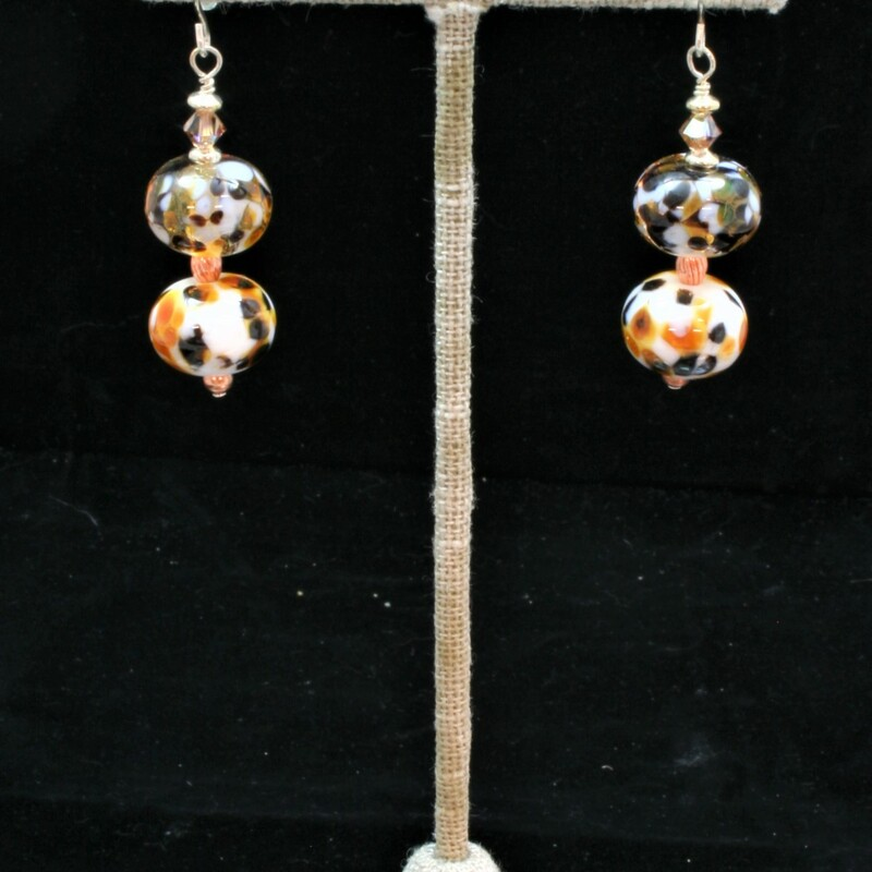 From the Serengetti collection of Gladmist Glass Design. Hand torched glass bead earrings are finished with Sterling Silver, Swarovski crystals and copper.