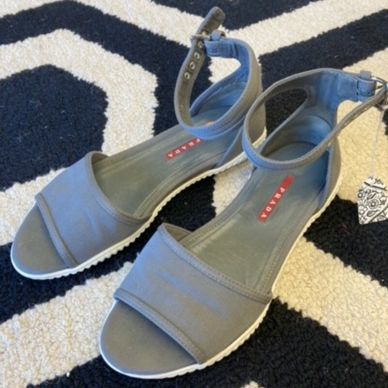 Prada  Sandal: A comfortable style for warm weather.  Lightly used.  Gray. Sz 9