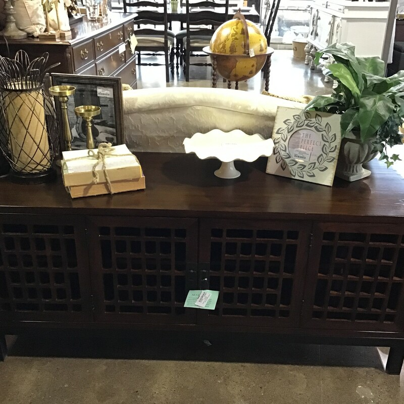 "This dark wood tv stand featuers 2 large hinged doors and intricate wood detail on the front. There are 2 interior shelves and holes in the back for your cables. Great piece for your game room or family room!<br /> Dimensions are 56"" x 20"" x 24"""