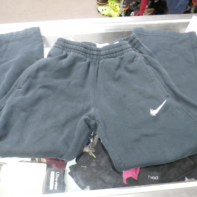 "Nike YOUTH sweat pants black size small cotton blend #25712<br /> Rating: (see below) 4- Fair Condition<br /> Team: n/a<br /> Player: n/a<br /> Brand: Nike<br /> Size: YOUTH Boy's SMALL (Measured Flat: Waist 11"", length 30"" 22"" inseam)<br /> Color: black<br /> Style: sweat pants; drawstring and elastic waist; straight leg<br /> Material: 80% Cotton 20% polyester<br /> Condition: 4- Fair Condition; wrinkled; material is stretched out slightly; some pilling and fuzz; noticeably faded and discolored; small hole near the Left Hip; the swoosh is coming un-sewn; overall worn looking<br /> Item #: 25712<br /> Shipping: FREE"