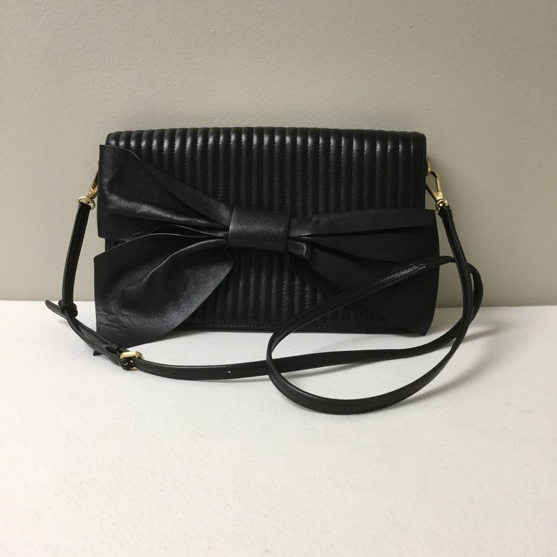 Donna Karan Bow Clutch<br /> Size Small<br /> Color Black<br /> Price $76.00