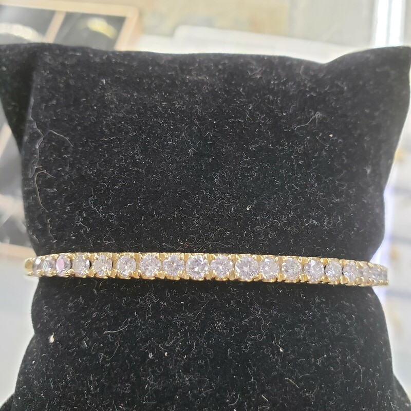 Diamond Bangle Bracelet<br /> 2ct total weight set in 14k yellow gold<br /> H-I color SI1-2 Clarity<br /> <br /> Pictures do not do the jewelry justice.<br /> Photo ID required for pick up of online purchases. We will not ship jewelry purchases.<br /> <br /> All jewelry has been checked by a Certified Gemological Institute of America (GIA) Accredited Jewelry Professional (AJP) and/or appraised by a certified local jeweler.