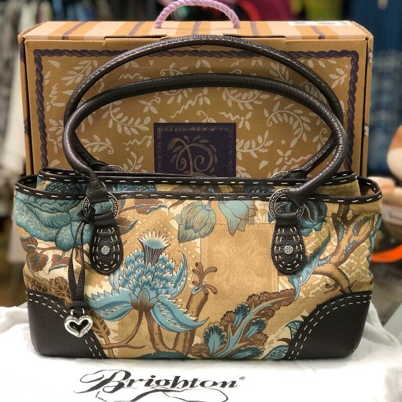 "BRIGHTON<br /> -Comes with the box, certificate and dust cover<br /> -This is a Brighton Matisse Handbag Tote Purse (Blue Crush)<br /> -Floral pattern Leather Trim<br /> -Center Magnetic Snap Closure<br /> -4 Exterior Slip Pockets<br /> -all around the Bag Bottom of bag has 4 round feet to protect the bottom Interior of the bag<br /> -has 2 zip pockets, 2 slip pockets, and the lining is tan swirl print<br /> -Leather Key Holder inside<br /> -8.5"" handles<br /> -Open outer wall side pockets<br /> -14\""Wx9\""Hx4\""D<br /> -This bag is in LIKE NEW CONDITION!!!<br /> -This handbag is in Amazing condition and can be given as a gift."