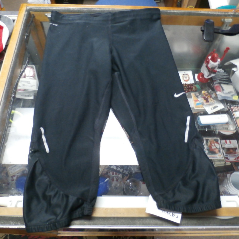 "Nike Dri-Fit black athletic capris size XS polyester/spandex blend #25510<br /> Rating: (see below) 2- Great Condition<br /> Team: n/a<br /> Player: n/a<br /> Brand: Nike<br /> Size: Women's XSmall- (Measured Flat: Waist 12""; length 21""; inseam 14"")<br /> Color: black<br /> Style: athletic capris; elastic waistband<br /> Material: 92% polyester 8% spandex<br /> Condition: 2- Great Condition: gently used; minor discoloration (see photos)<br /> Item #: 25510<br /> Shipping: FREE"