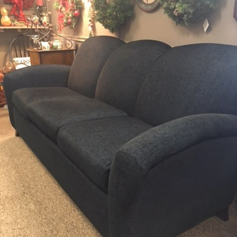 Beautiful modern navy blue couch in like new condition.  Very comfortable and stylish.