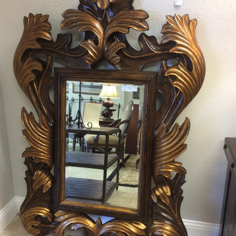 This large mirror by Marge Carson is gorgeous! A bold, ornate black and gold leaf pattern frames the mirror which actually is not very large in and of itself. This mirror is so unique and eye-catching it could very well define the room.