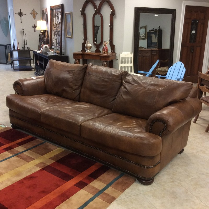 This leather sofa is beautiful! Made by Klaussner it is from their Distinctions Collection - and distinct it is! Large with nice, deep seating the leather is delicious,soft and broken in. Chocolate brown with a nailhead trim. Great condition and priced very well. Come take a look, SOON!