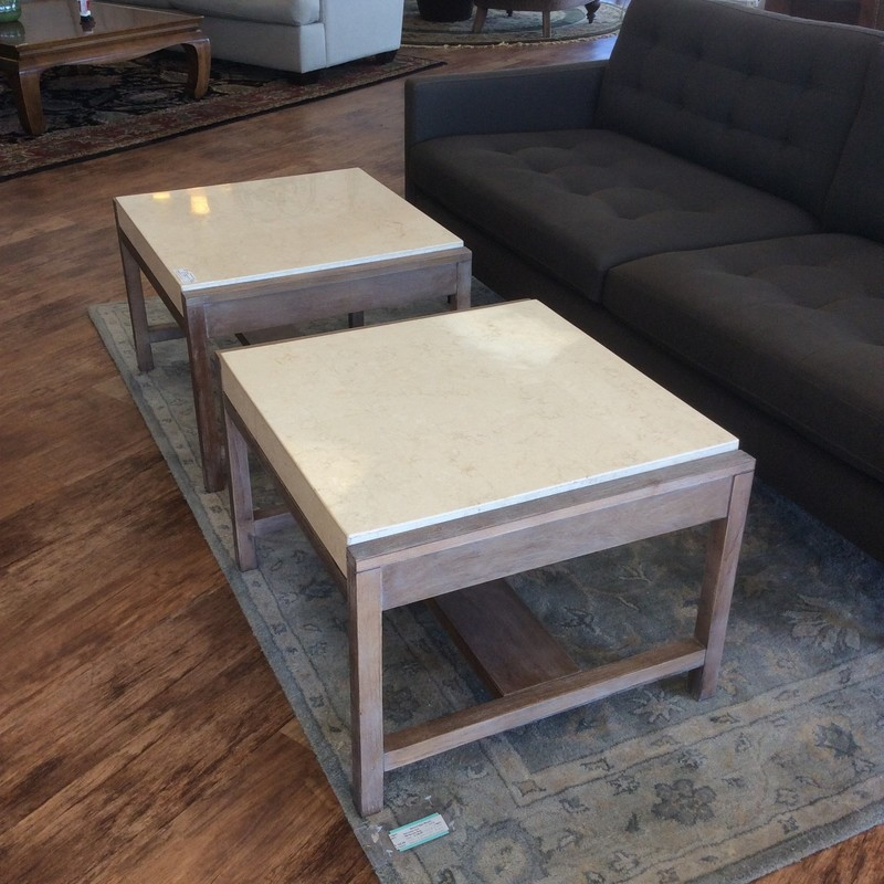 So stylish, this pair of end tables! Contemporary in design with a cream colored faux marble top and framed in wood. This duo would match and mix perfectly with YOUR living room furniture. They've seen a little wear but overall,still in very good shape.